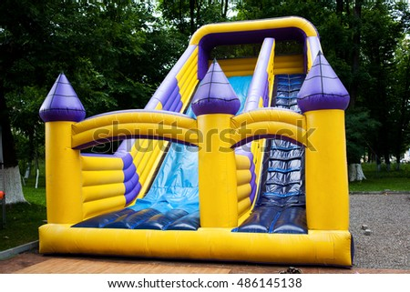 Inflatable big bouncy castle slide in a park