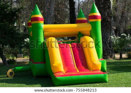 Inflatable castle game green with yellow in the garden