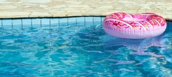 Inflatable in outdoor swimming pool on a hot sunny summer day