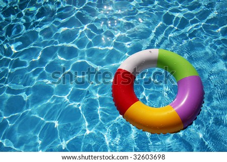 Inflatable Rubber Ring floating in a beautiful blue pool
