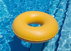 inflatable yellow inner tube floating in clear blue waters