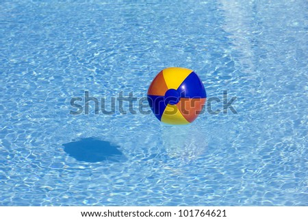 inflated plastic ball flying in the pool