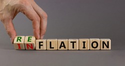 Inflation or reflation symbol. Businessman turns cubes and changes the word inflation to reflation. Beautiful grey background, copy space. Business, inflation or reflation concept.