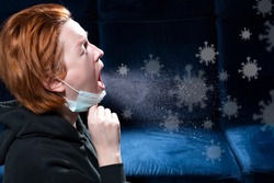 Influenza, cold, coronavirus. Infection through an airborne droplet. Girl in a hood and in a medical mask in front of a cloud of drops in the air. Visible coronavirus particles in the air.