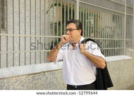 Influenza: Man coughing outdoors