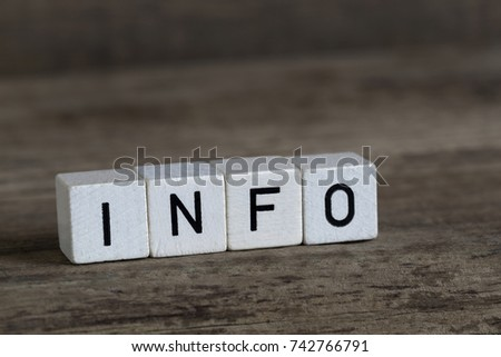 Info, written in cubes on a wooden background #742766791