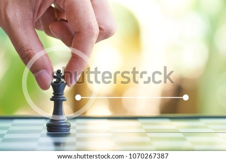 Infographics of Businessman holding a King Chess is placed on a chessboard.using as background business concept and Strategy concept with copy space for your text or design. - Shutterstock ID 1070267387