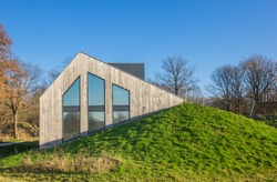 Information center of the Noordsche Veld nature area built in a dike near Norg, Netherlands
