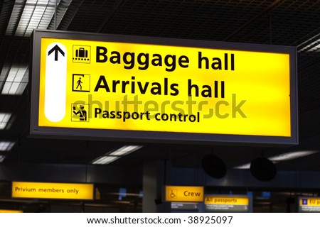 Information sign in airport. Baggage and arrivals halls directions