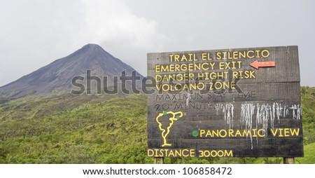Information sign in front of Volcano Arenal in Costa Rica - La Fortuna, Alajuela province, Costa Rica