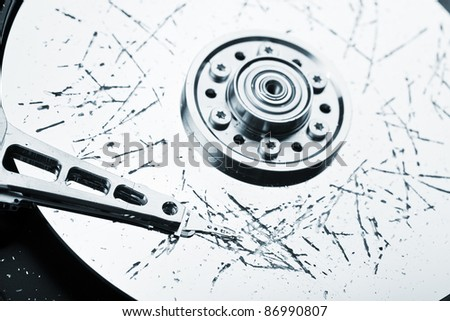 Information storage data loss concept - broken computer technology hard disk drive surface