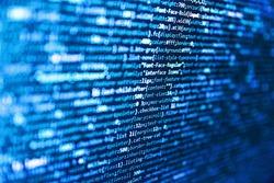 Information technology website coding standards for web design. Computer script coding source code on desktop monitor. Computer programming source code