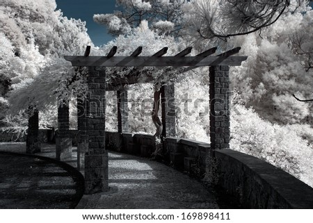 Infrared photo of a mountain road gazebo in northern Portugal that allows rest and enjoy the scenery