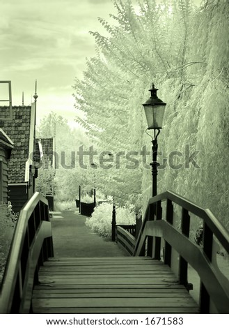 Infrared photo of a wooden bridge and Dutch houses