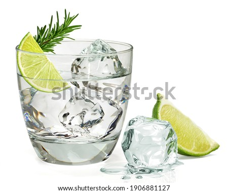 Infused rosemary vodka or gin tonic with sliced lime in glass isolated on white background. Zdjęcia stock ©