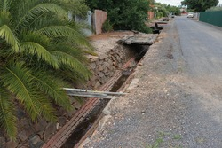 INGLEWOOD, VICTORIA – November 30, 2019: Storm Lane drain (1862) is a stone rubble drain with a brick base. It moves stormwater to the larger drain in Heales Street and into the Bul-a-Bul creek