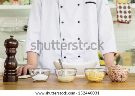 ingredient preparation by chef for making of tuna spread sandwich