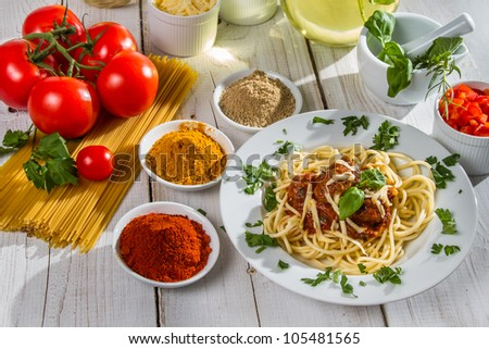 Ingredients and fresh vegetables to spaghetti