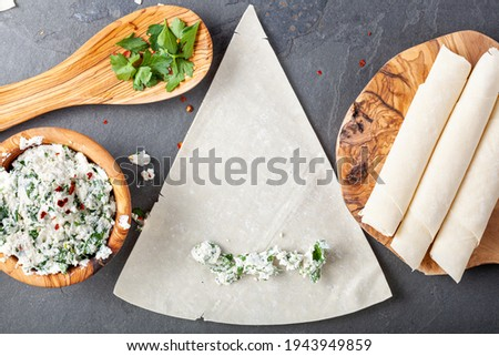 Ingredients and preparation of traditional turkish phyllo dough rolls (Sigara boregi) A deep fried cheese or meat rolls popular in Turkey