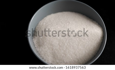 Ingredients and products in the kitchen. Sugar sand in a dish. The chef has prepared the ingredients for the future of the culinary product. Sweet