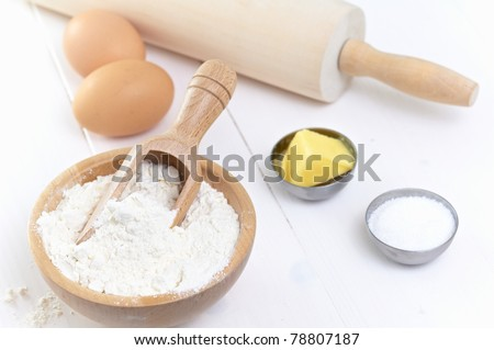 ingredients and tools to make a cake, flour, butter, sugar,eggs