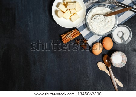 Ingredients cakes on a black background. Free space for your text