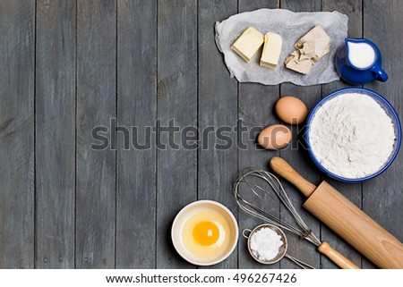 Shutterstock Ingredients cakes on a black background. Free space for your text.