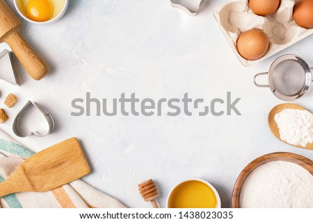 Ingredients for baking  - flour, wooden spoon, rolling pin, eggs. Top view, copy space. #1438023035