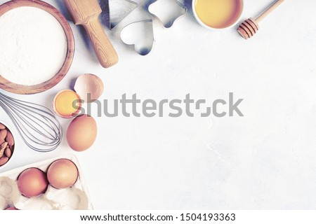 Ingredients for baking  - flour, wooden spoon, rolling pin, eggs. Top view, copy space. #1504193363
