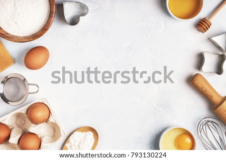 Ingredients for baking  - flour, wooden spoon, rolling pin, eggs. Top view, copy space. #793130224