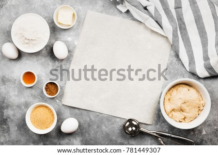 Ingredients for baking of cookies - flour, eggs, spices, vanilla, butter, sugar. Top view, copy space. Food background