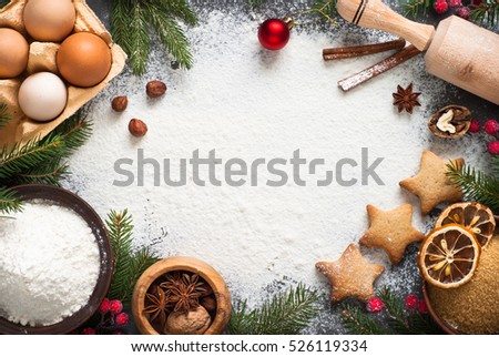 Ingredients for cooking christmas baking. Flour, eggs, brown sugar and spices. Top view with copy space.