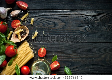 Ingredients for cooking Italian pasta - spaghetti, tomatoes, basil and garlic. #313766342