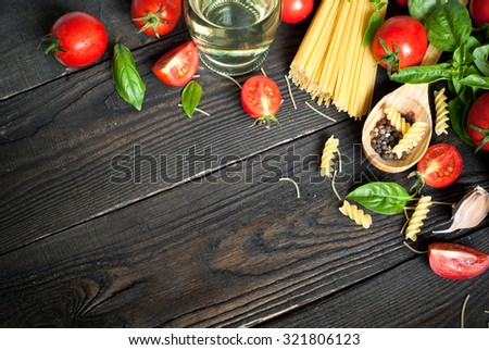 Ingredients for cooking Italian pasta - spaghetti, tomatoes, basil and garlic. Top view, copy space. #321806123