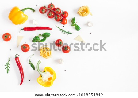 Ingredients for cooking pasta on white background. Fettuccine, fresh vegetables, cheese, mushrooms, spice. Italian food concept. Flat lay, top view, copy space.