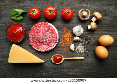 Shutterstock Ingredients for cooking pizza on wooden table, top view