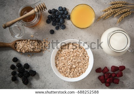 Ingredients for dieting healthy breakfast on stone slate. #688252588