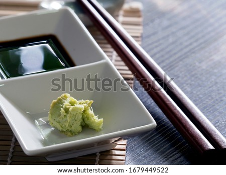 Ingredients for dipping, eaten with salmon, sashimi and shushi, popular Japanese food. Soy sauce called shoyu and wasabi. Enhances the taste of raw fish to be more delicious. Don't eat wasabi too much Stock fotó ©