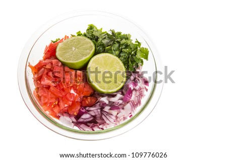 Ingredients for fresh salsa onion pepper tomato in bowl