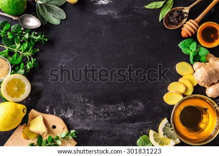 Ingredients for ginger tea with lemon and honey on slate plate