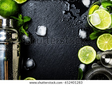 Ingredients for making alcoholic summer cocktail and bar tools, drink background, top view #652401283