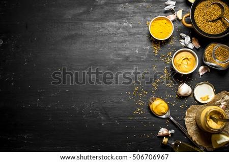 Ingredients for making mustard. On a black chalkboard. #506706967