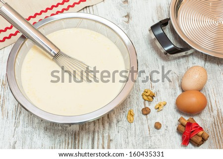 Ingredients for making pancake  batter. Batter making ingredients ready for making pancakes, on  wooden table. Viewed from above