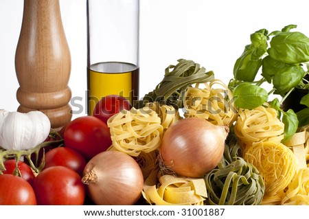 Ingredients for pasta with vegetables in studio with white background