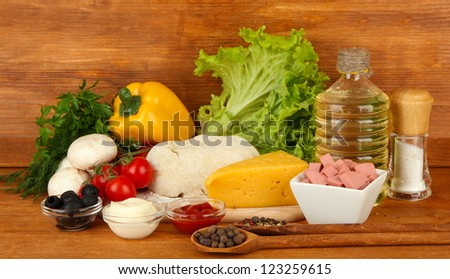 Ingredients for pizza on brown background