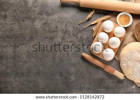 Ingredients for preparing bakery on grey table