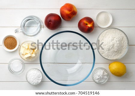 Ingredients for step by step recipe pie or galette on white wooden table. Baking background top view. #704519146