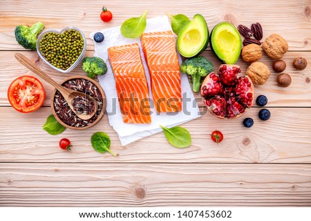 Ingredients for the healthy foods selection. The concept of healthy food set up on wooden background. #1407453602