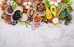 Ingredients for the healthy foods selection. The concept of superfoods set up on white shabby concrete background with copy space.