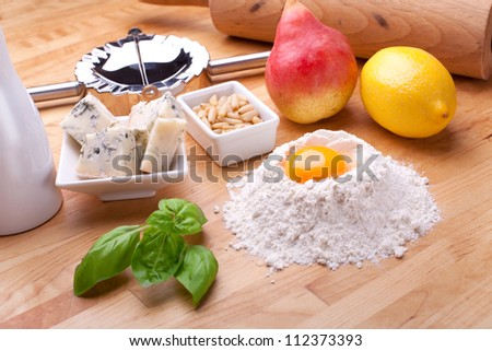 ingredients for traditional italian homemade pasta,  ingredients for ravioli pasta filled with pear and gorgonzola cheese